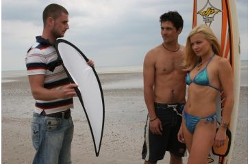 """Lastolite 12"""" Collapsible Reflector - Silver/gold in Use"""