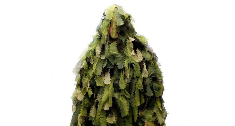 blend into the forest with a ghillie suit